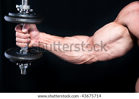 Bicep with hand weights  close up , isolated on black background
