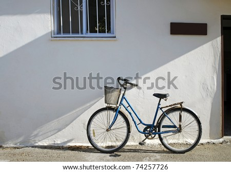 Bicycle against Stucco Building