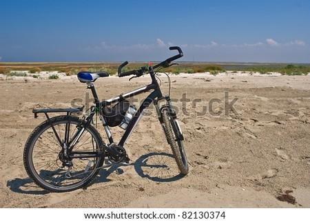 bicycle among a sandy desert