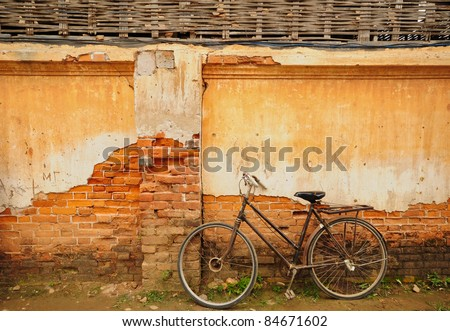 bicycle and old house