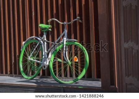 bicycle bike cycle wheel,  Wooden Board, Fence a barrier, railing, or other upright structure, typically of wood or wire, enclosing an area of ground to mark a boundary control access or prevent escap #1421888246