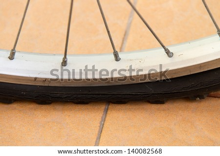 Bicycle flat tire on the tiles