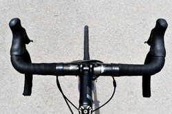 Bicycle handlebar from above as the cyclist sees it during a ride