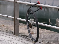 Bicycle has been stolen leaving only one wheel locked to railings