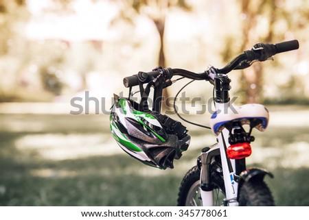 Bicycle helmet on the handlebar #345778061