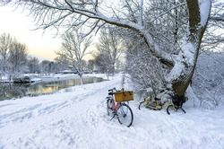 Bicycle in snowy rural scene. Two bicycles in snow. Snowy rural nature bicycles