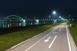 Bicycle lane with white bicycle sign at night