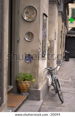 Bicycle leaning against a wall in Europe.