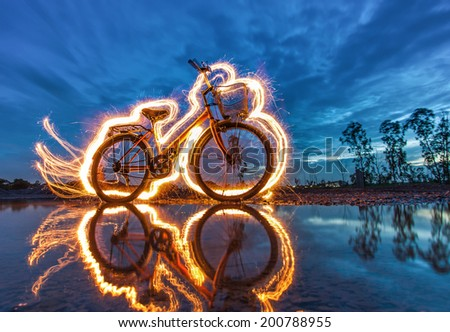 Stock Photo bicycle light painting reflection