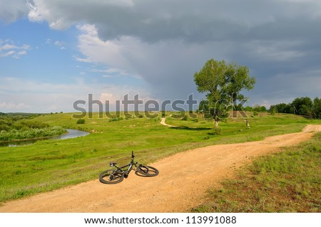 bicycle lying near the river