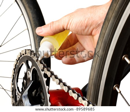 Bicycle Maintenance- oiling the chain #89589685