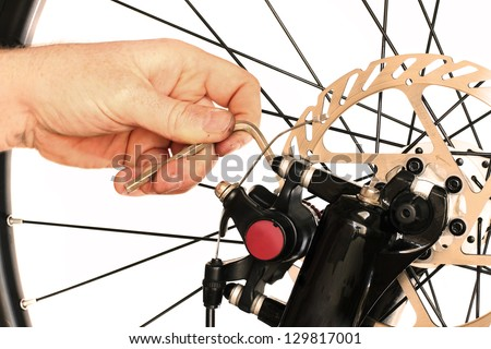 Bicycle Maintenance- Repairing the Disc Brakes on a Mountain Bike - stock photo