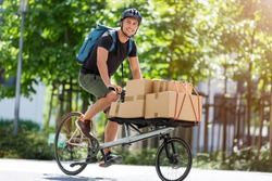 Bicycle messenger making a deliveryon a cargo bike