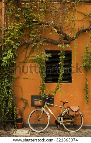 bicycle on a orange wall with...