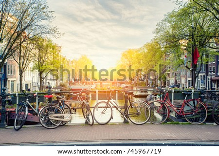 Bicycle on the bridge with Netherlands traditional houses and Amsterdam canal in Amsterdam ,Netherlands.