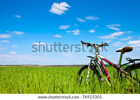 bicycle on the field - tourism concept
