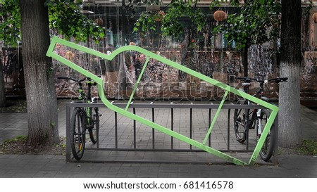 Bicycle parking in the form of contours and silhouette of the bottle #681416578