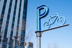 Bicycle parking sign in the park in Odaiba, Tokyo, Japan.