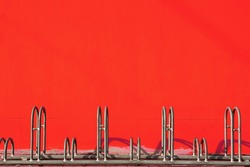bicycle parking with red wall background