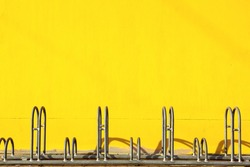 bicycle parking with yellow wall background
