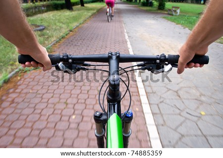 Bicycle path rider, motion blur, commuting to work