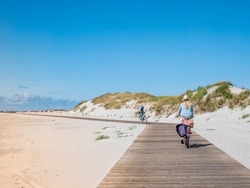 Bicycle path to the beach at the North Sea