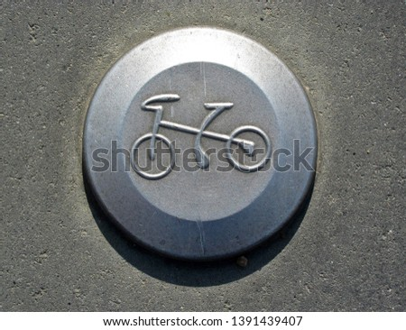 Bicycle pictogram on a bicycle track. Traffic, object. #1391439407
