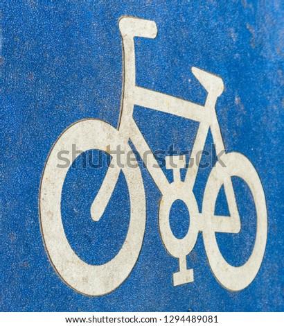 Bicycle pictogram on asphalt #1294489081