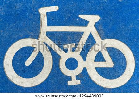 Bicycle pictogram on asphalt #1294489093