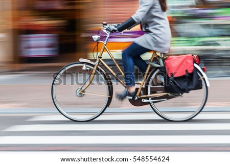 bicycle rider in the city in motion blur #548554624
