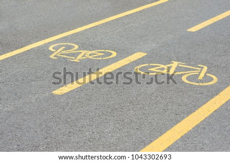 Bicycle road. Bicycle lane signage on street #1043302693
