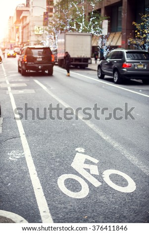 Bicycle road sign on asphalt. #376411846