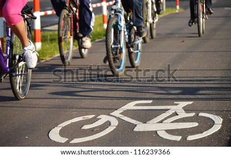 Bicycle road sign on asphalt. Leisure activities