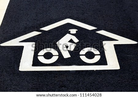 Bicycle Sign On The Asphalt