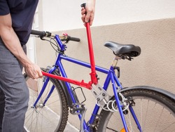 Bicycle thief trying to cut a lock with a bolt cutter