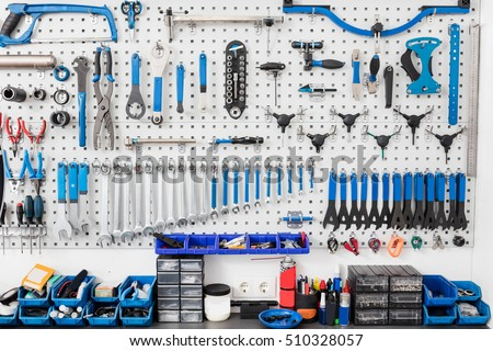 Bicycle tools in the board. Bike mechanic garage with workshop tools wall. Repair concept.
