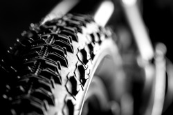 Bicycle wheel and tire close up on tread abstract