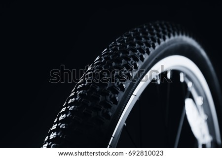 Bicycle wheel on black background #692810023