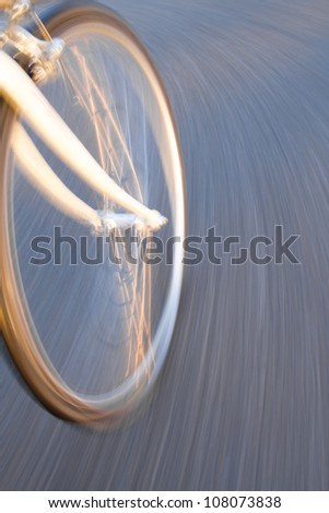 bicycle wheel on street in motion