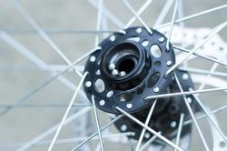 Bicycle wheel repair. Replacing the bearings on the front hub.