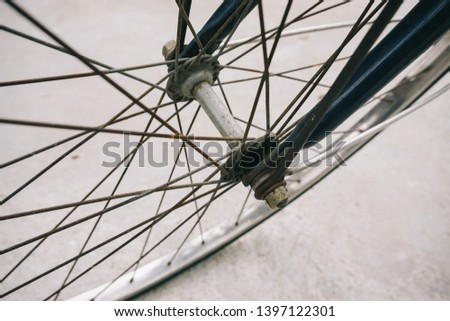 Bicycle wheels on the gray cement floor #1397122301