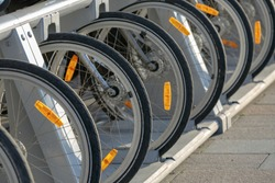 Bicycle wheels with orange retroreflector and Cat-Eye on a bicycle close-up in Parking lot