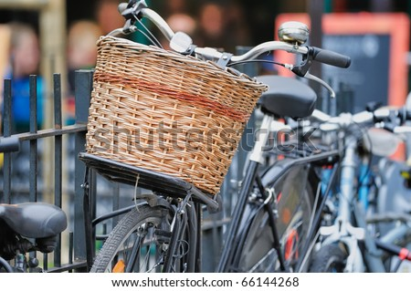 Bicycle with wicker basket on the city street. Photo with tilt-shift lens