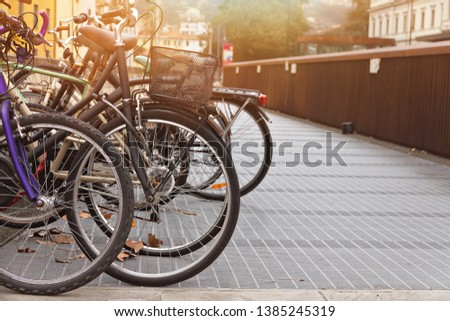 bicycles are parked in the city near the train station in Italy, Tuscany