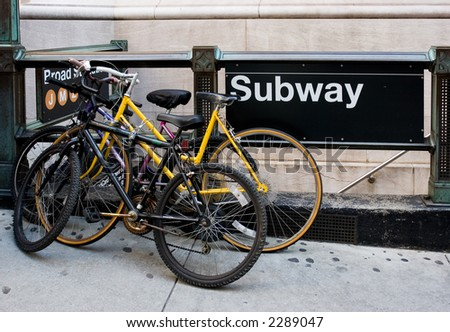 Bicycles beside subway station entrance in New York City.