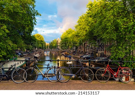 Bicycles Parked Along a Bridge Over the Canals of Amsterdam Netherlands