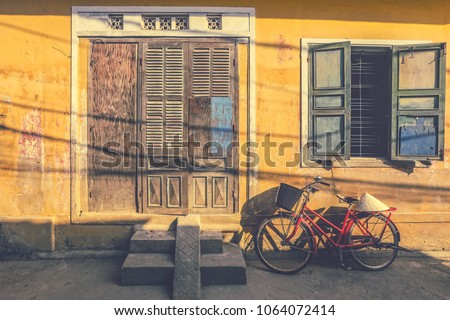 bicycles parked near yellow...