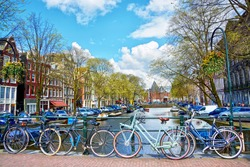 Bicycles parked on a bridge in Amsterdam, The Netherlands