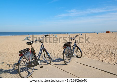 Bicycles parked on a sandy beach in Hoek Van Holland, The Netherlands Stok fotoğraf ©