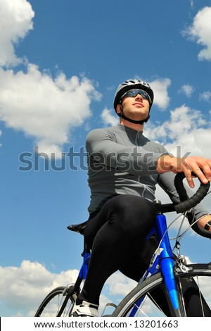 bicyclist on a background of the sky
